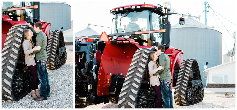 Nicole Corrine Couple Standing with a red tractor farm enagement session Iowa.jpg