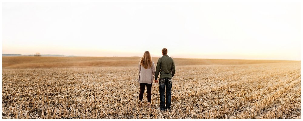 Iowa Engagement Session Couple standing in corn field Nicole Corrine.jpg