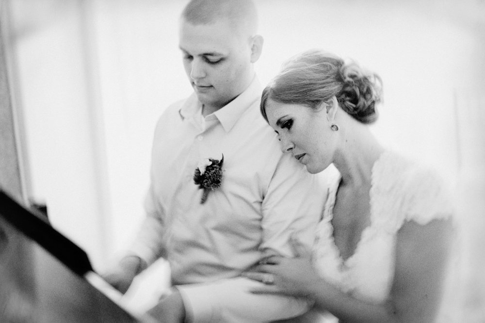 Nicole Corrine Black and White Bride and Groom with Piano Snowden House Waterloo Iowa romantic.jpg