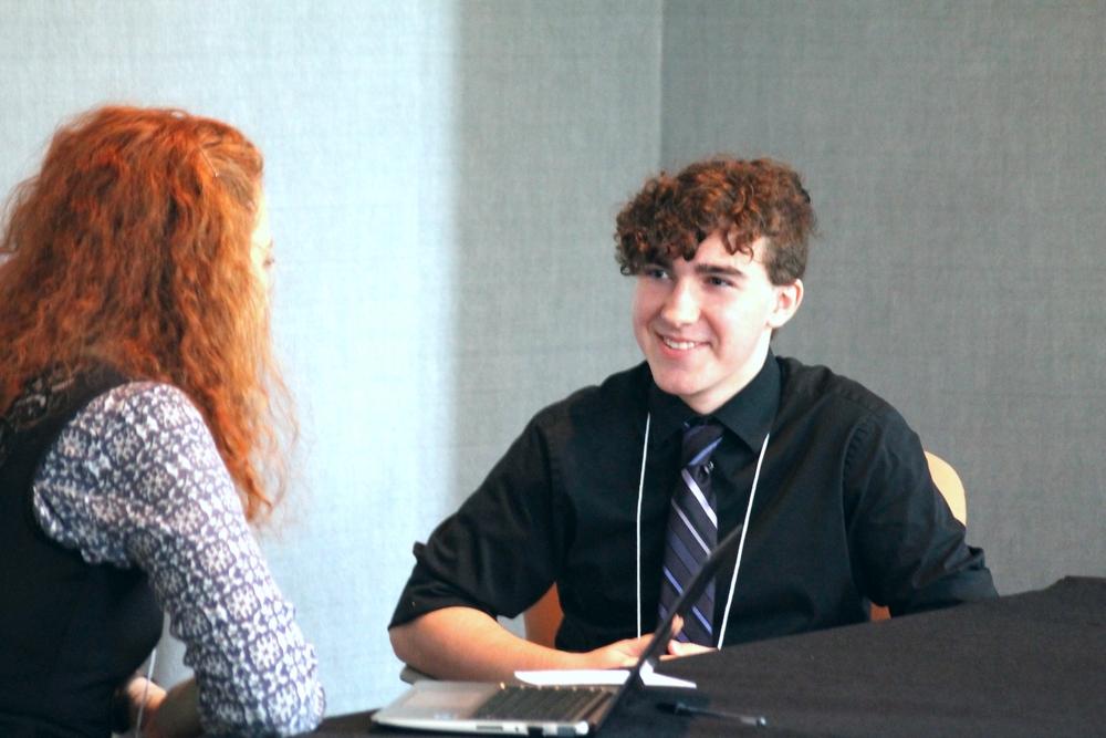 Reporter Katarina Radu interviewing delegate Cade Shortt