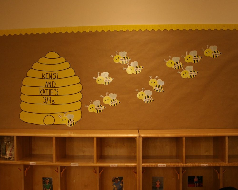 Students' names are displayed above their cubbies in the 3/4s room.