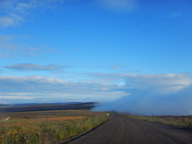Fog bank rolling over the Eagle Plains Plateau, Dempster Highway, YT