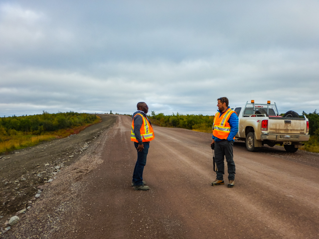 Learning about the construction process from our escort, Mackenzie Valley Highway, NWT
