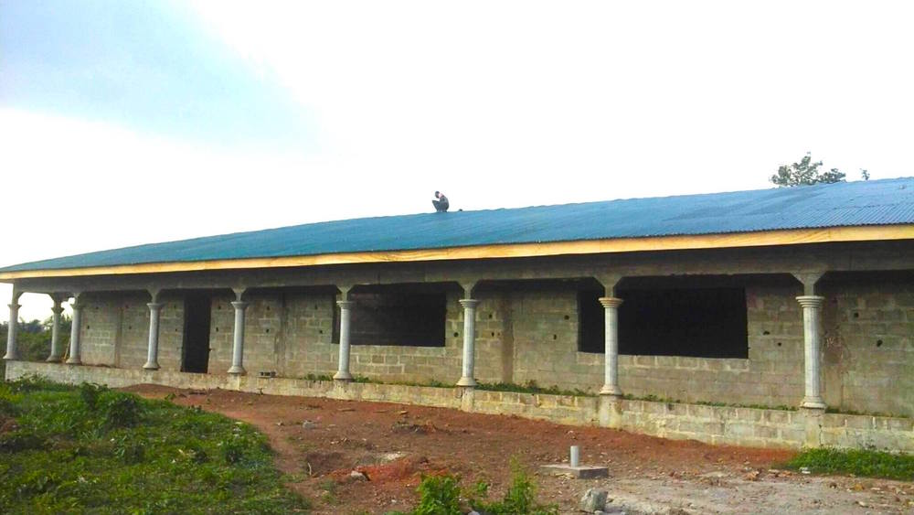 School Building # 3 roofed in Lofa County, Northern Liberia. Getting it ready for operation comes September 2016