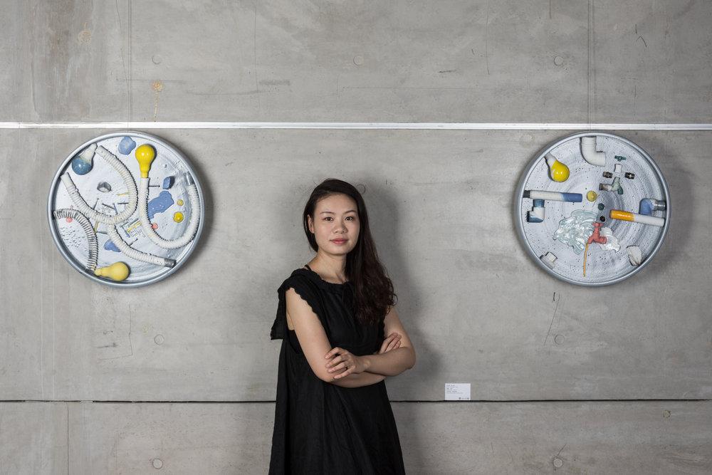 RenqianYangat her solo exhibition at Ceramic Art Avenue Art Gallery,Jingdezhen©RenqianYang, courtesyCeramic Art Avenue Art Galleryand Fou Gallery