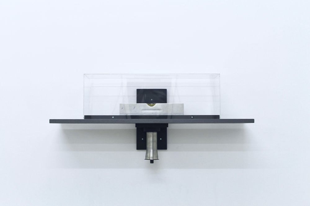 The stunning sculpture  Point of Balance , 1983-86, Sicilian marble, glass, spirit-level unit, steel weight and MDF shelf, 41.3x91.4x22.8cm by Tony Carter