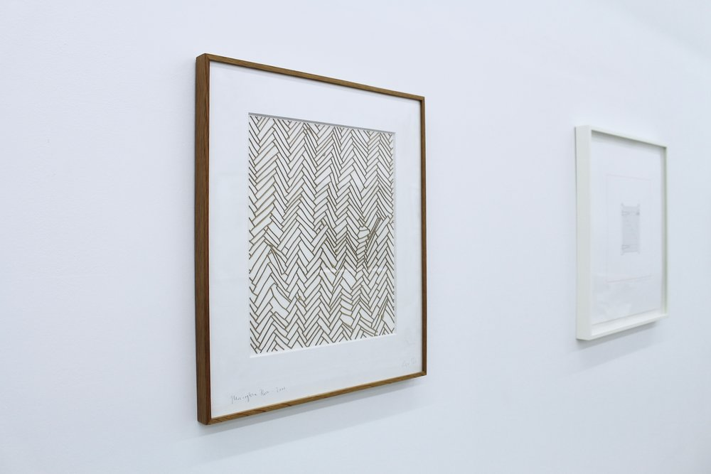 Rachel Whiteread,  Herringbone Floor , 2001, Laser-cut relief in 0.8mm Finnish birch, 51x44cm (left)  Michael Craig-Martin , Gate, 2015, Letterpress edition print, 48.2x48.2cm