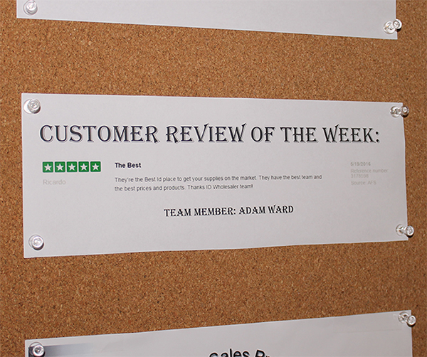 An ID Wholesaler Sales Manager features one of her reps' reviews on their motivation board.