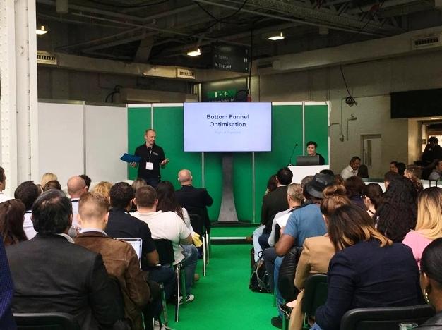 Trustpilot's Alan Duncan speaks at a presentation alongside Sugru