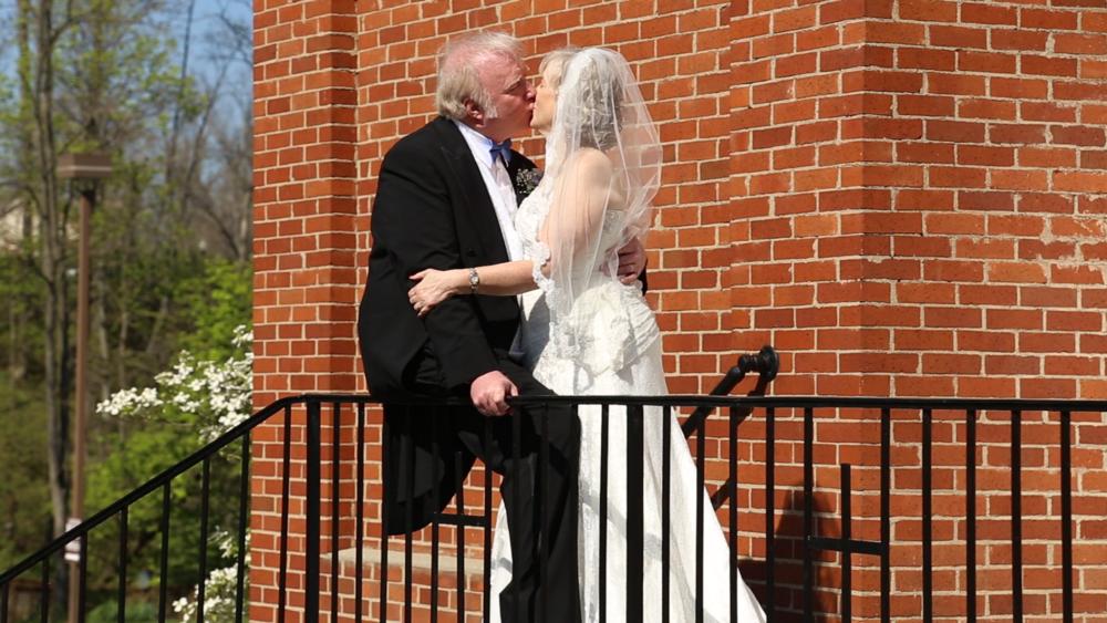 Nancy & Garry Kiss.png