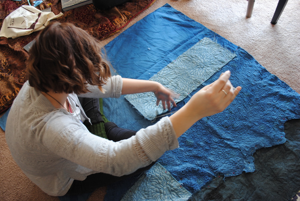 Claire busy at work constructing a beautiful indigo tent.