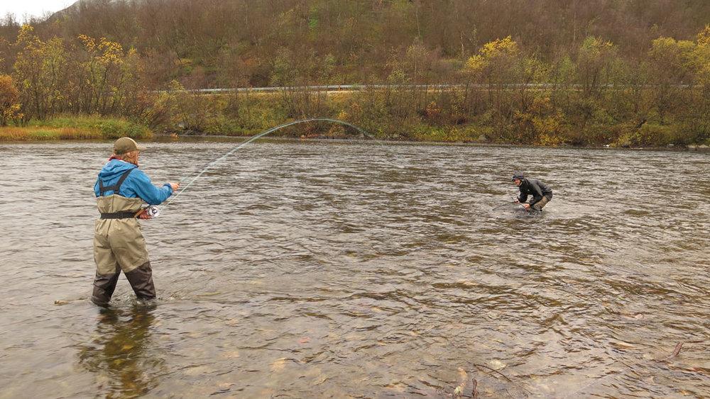 Anglers landing an Atlantic salmon. Robert Lennox photo.