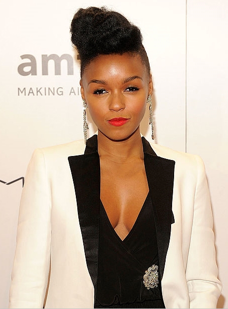 Make a sultry statement like songstress Janelle Monae with a two piece suit; think tapered trousers, an open blazer with a lace camisole this outfit has just the right amount of sexy.