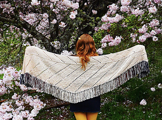 Untitled #1 is a shallow, elongated triangle shawl with a marled fringe border. The body of the shawl is knit sideways in garter stitch, with alternating eyelet rows to add dimension and interest.   Download from Ravelry Here