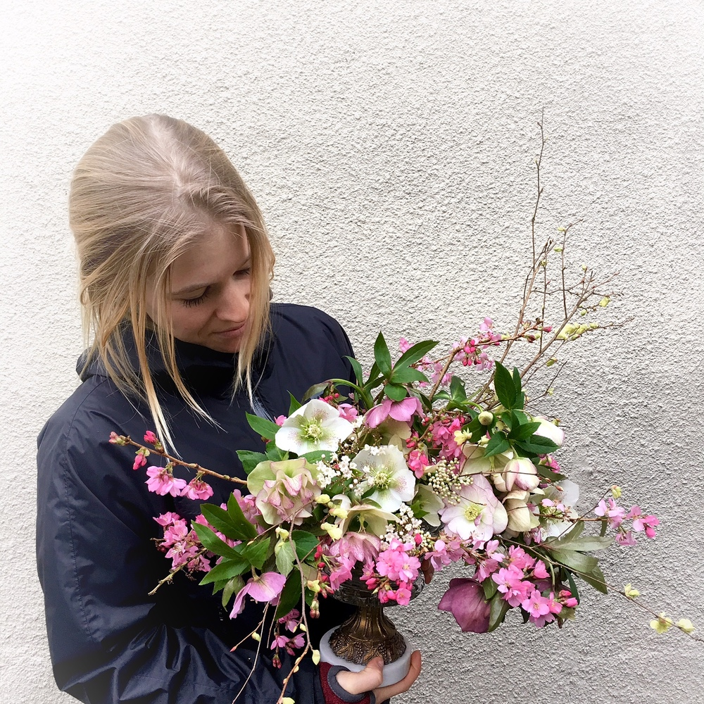 The beautiful Anna, holding an arrangement of February's flowers