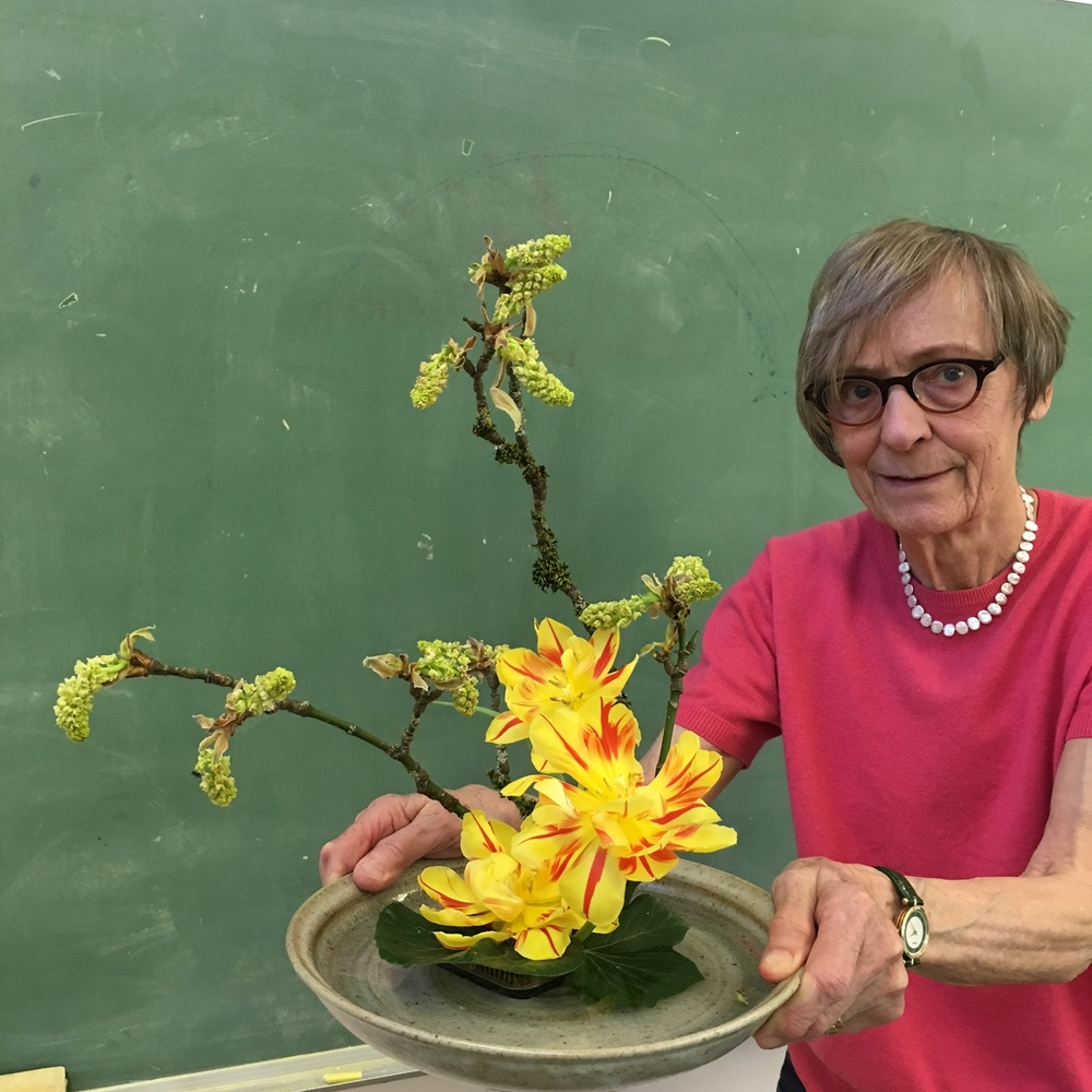 Margaret with big leaf maple blossoms and tulips