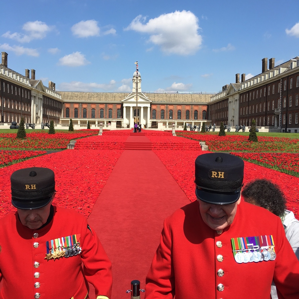 Veteran residents of the hospital. Thousands of commemorative crocheted poppies covering the ground.