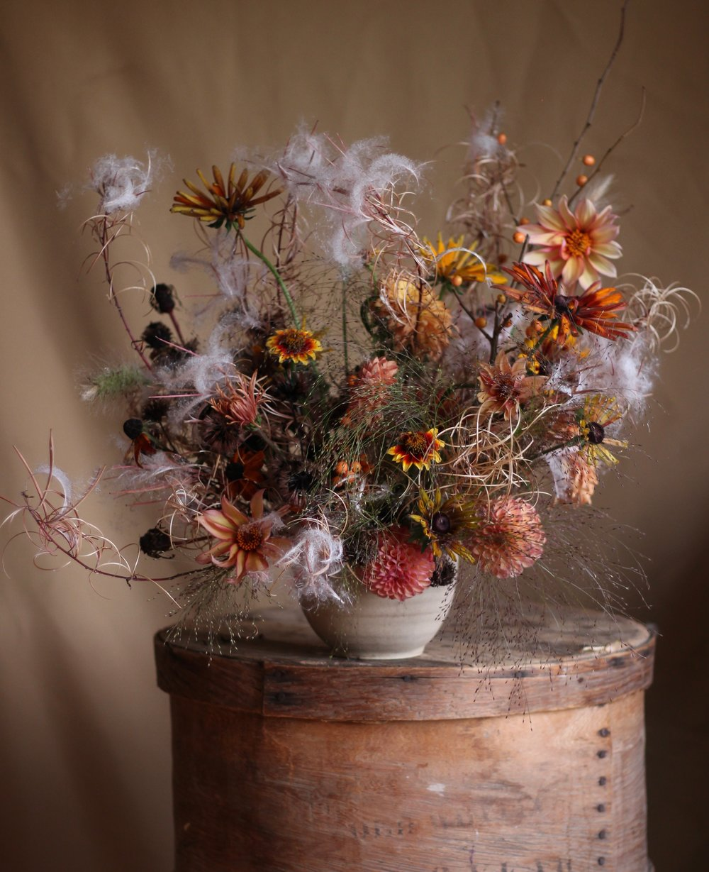 The seed heads of the BC native Chamerion angustifolium with Frosted Explosion grass and October's flowers from the garden