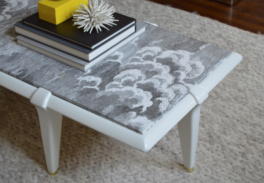 Coffee table refinished with white lacquer and Fornasetti wallpaper
