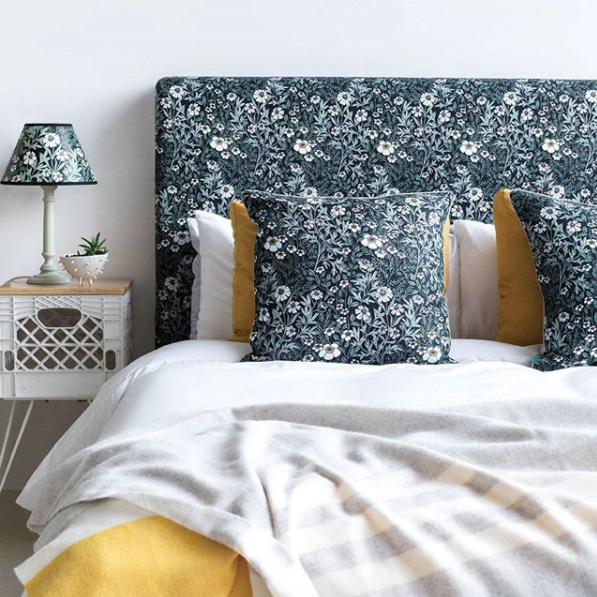 Headboard upholstered in Fever Few Midnight fabric from Abigail Borg