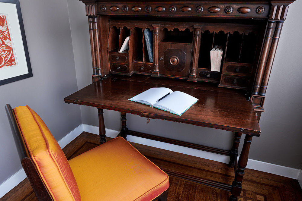 Restored antique desk and reupholstered vintage chair by Revitaliste