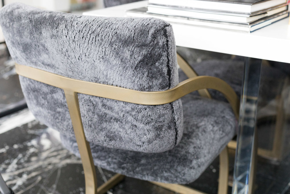 Vintage chairs reupholstered in charcoal grey shearling with matte brass powder coated frames by Revitaliste | Design by HSH Interiors