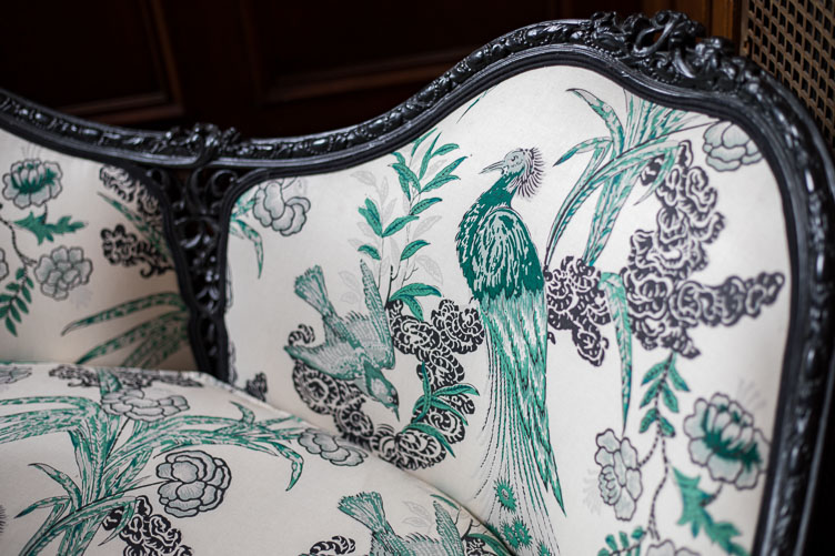 "Revitaliste reupholstered this Antique French Settee in Schumacher ""Peacock"" in Emerald and lacquered it in a high gloss black lacquer."