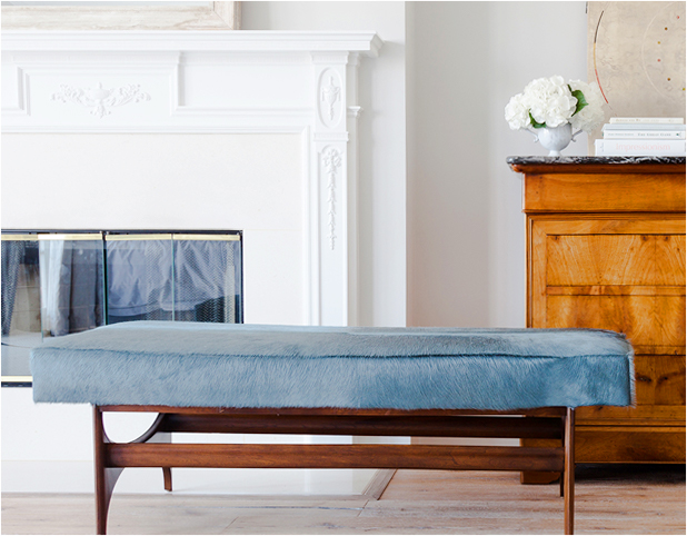 Revitaliste reupholstered this Mid-Century Modern Bench in Holland & Sherry custom color hair-on cowhide.