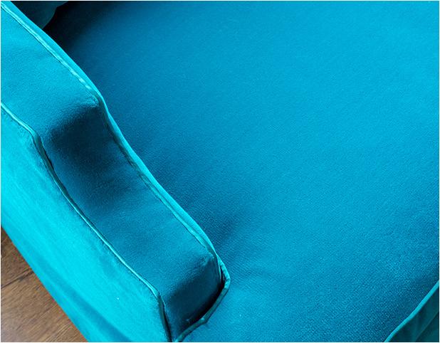 "Revitaliste reupholstered this Dorothy Draper Sofa in Pindler ""Titan"" in azul."