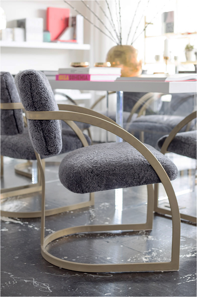 Revitaliste reupholstered these Vintage Milo Baughman Chairs in grey shearling from Keleen Leathers and powder coated the frames in a brass-like finish.