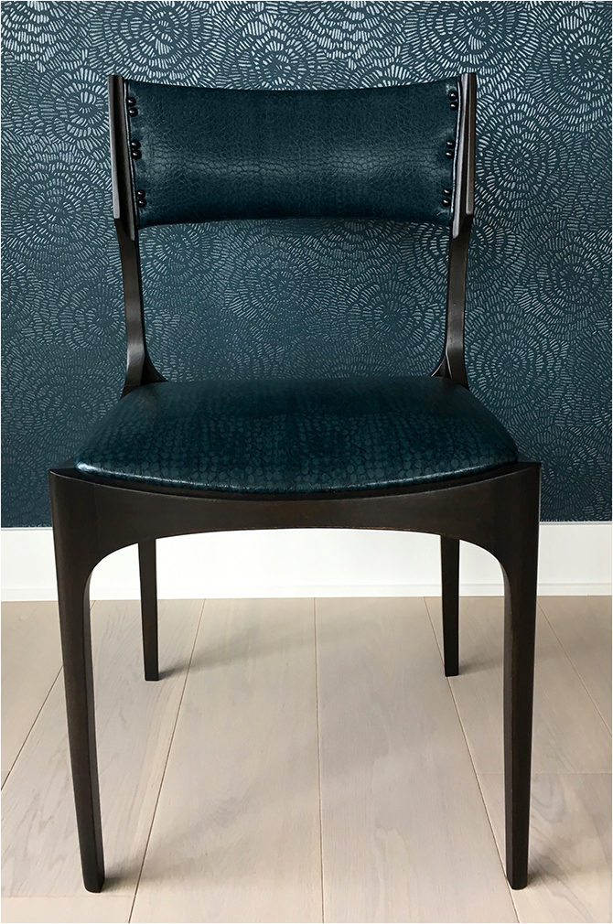 """Revitaliste upholstered these Mid-Century Dining Chairs in Robert Allen's """"Smooth Croc"""" upholstery vinyl in blue pine and refinished the wood frames in an espresso wood stain and satin clear coat."""