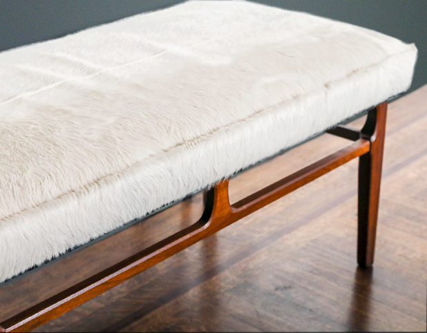 Revitaliste upholstered this Mid-Century Modern Bench in white hair-on cowhide.