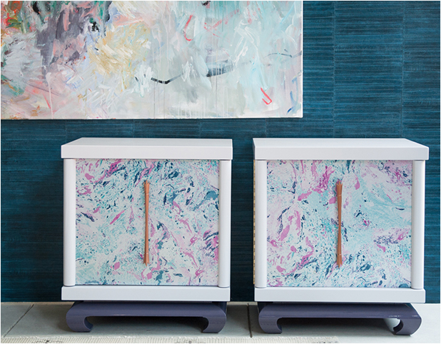 Revitaliste lacquered the exterior in a pale lavender lacquer, lacquered the base in a darker lavender, and wrapped the door face and interior shelved in a marbleized wallpaper from Designer's Guild.