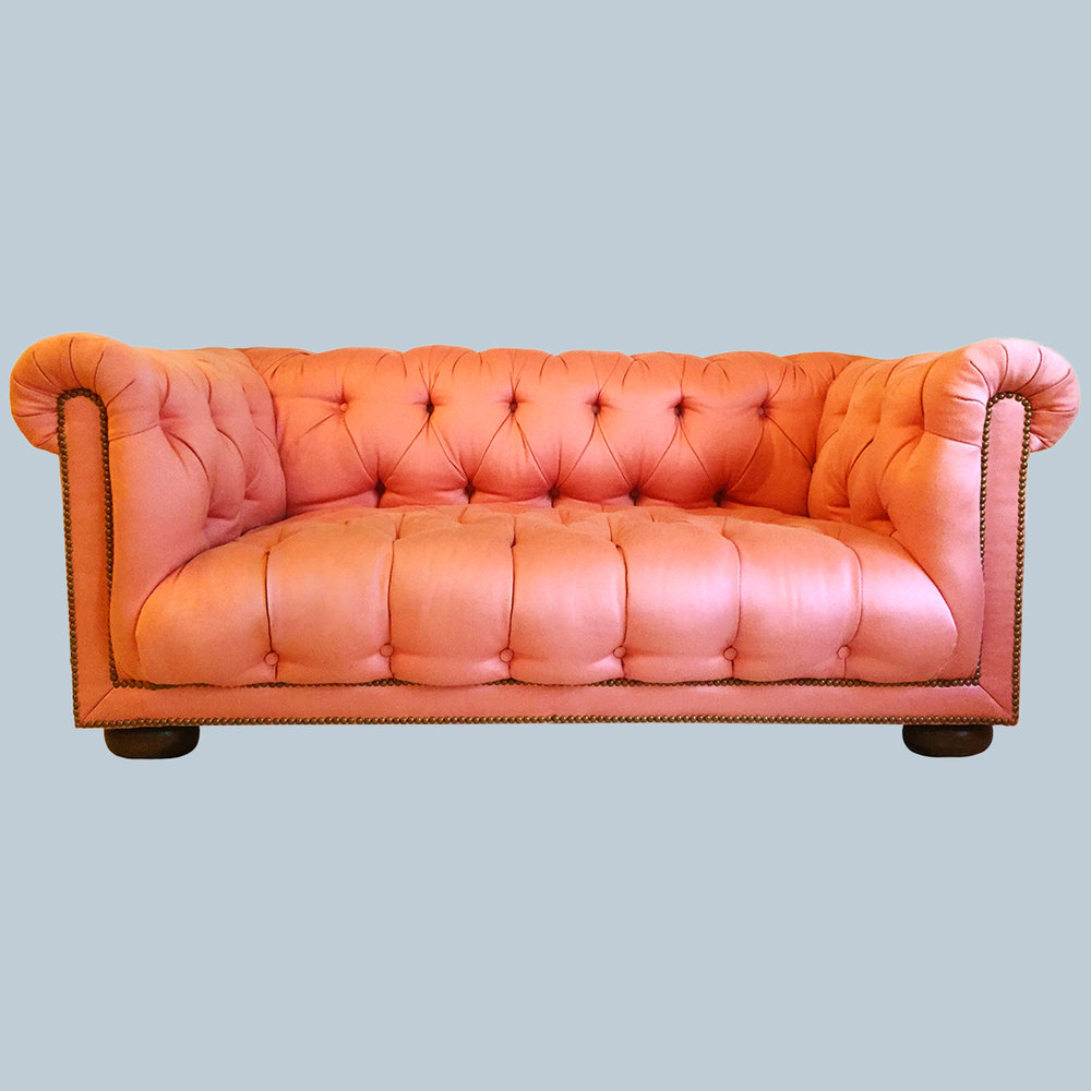 Chesterfield Sofa - Upholstered in pink indoor/outdoor fabric from Rose Cummings for Dessin Fournir, and legs refinished in a dark walnut.