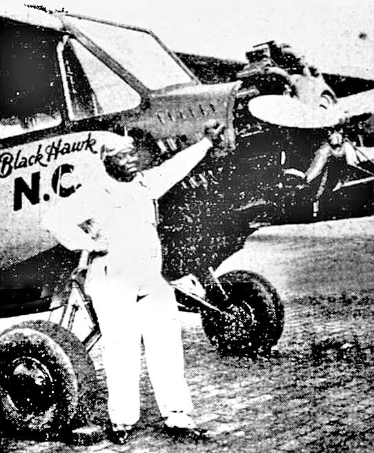 "Thomas ""Kid"" Hawkins and his ""Black Hawk"" airplane."
