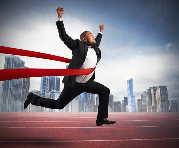 Successful businessman in a finishing line