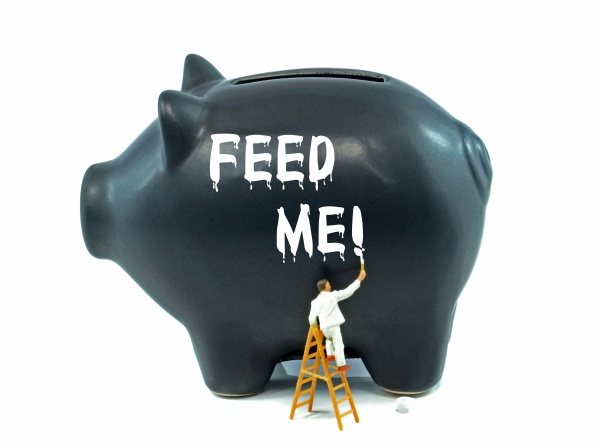 Financial money saving concept on a black piggy bank
