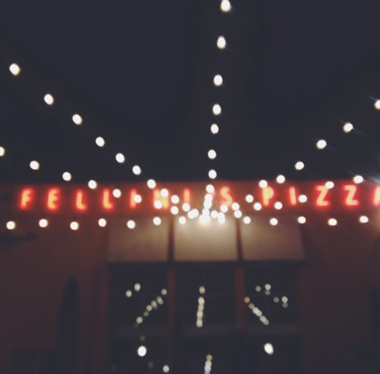 AshevilleFolk.com | Atlanta City Guide with Samantha Cole. , Fellinis has been serving late night snackers great pizza and calzones for years. For the best ambiance, visit the one on Ponce de Leon Ave. Most night they're open until 2am to satisfy all your pizza-y needs.