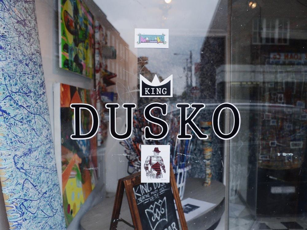 AshevilleFolk.com | Charleston City Guide with Jessica Tran & Rachel Faith. King Dusko. Downtown King Street. Art gallery, bar, hangout spot.
