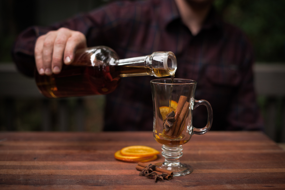Asheville Folk: A Grown-up Halloween by Chelsea Lane. Magic potion time. Cinnamon sticks + steaming apple cider + R um or Bourbon in your favorite mug.  Spiked cider keeps the party alive after your fall feast and  warms you up.