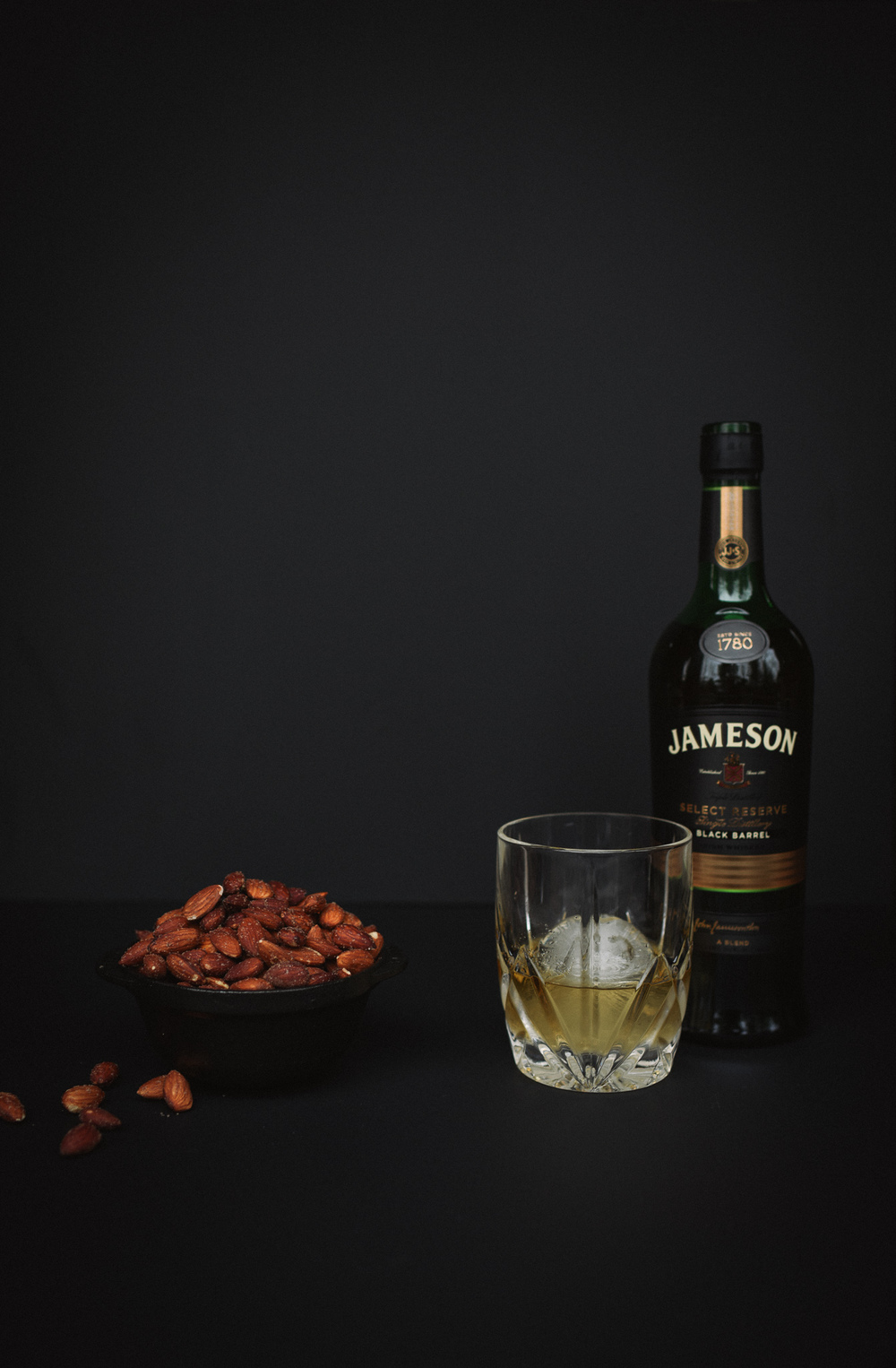 The Irish Classic: grab any whiskey from Ireland. Pour your Jameson (or whichever brand you choose) over a large ice cube for sipping. Pair this with our Smoked Almonds recipe. Photo by Chelsea Lane.
