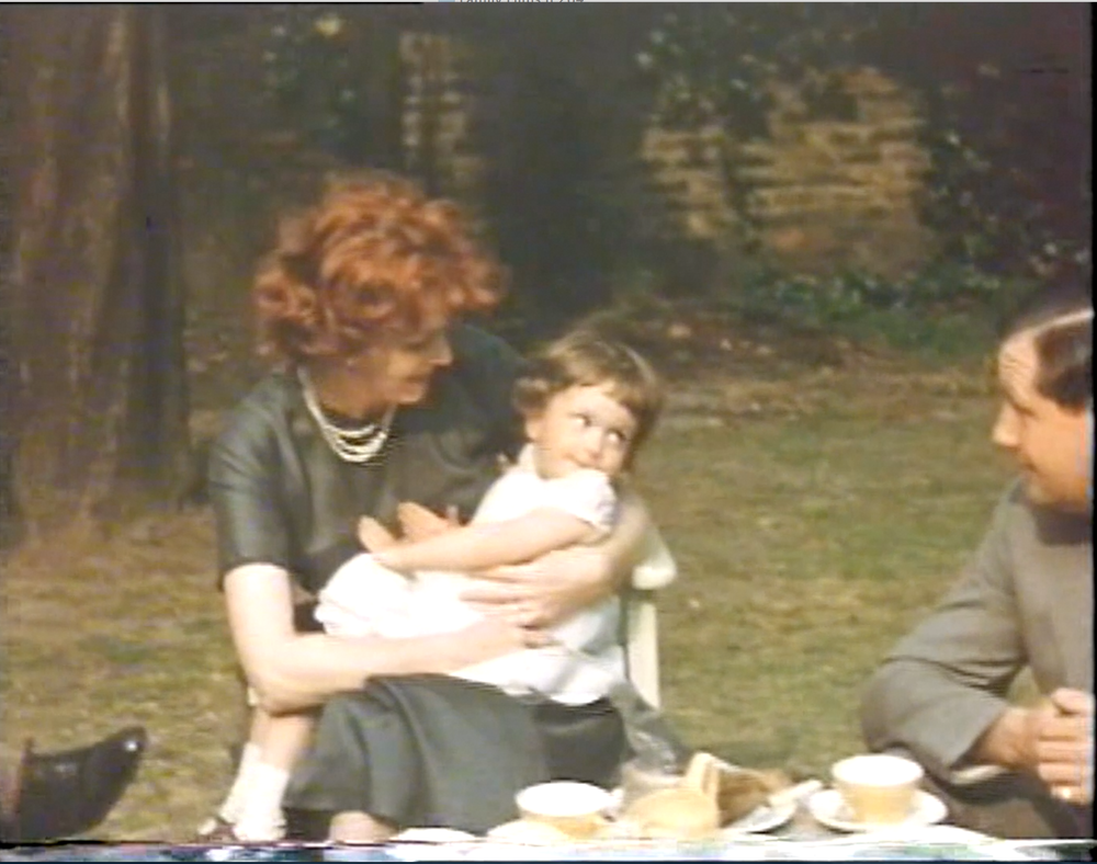 Maureen O'Hara with Monty and Stella's granddaughter, named 'Anne Maureen' (she is looking at dad). circa 1959. [Still from a family film]