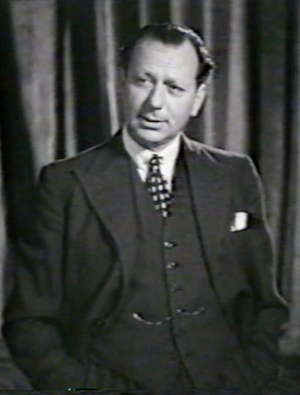 Still from a film of Montagu Marks speaking on Cinesound Review, Australia December 1937