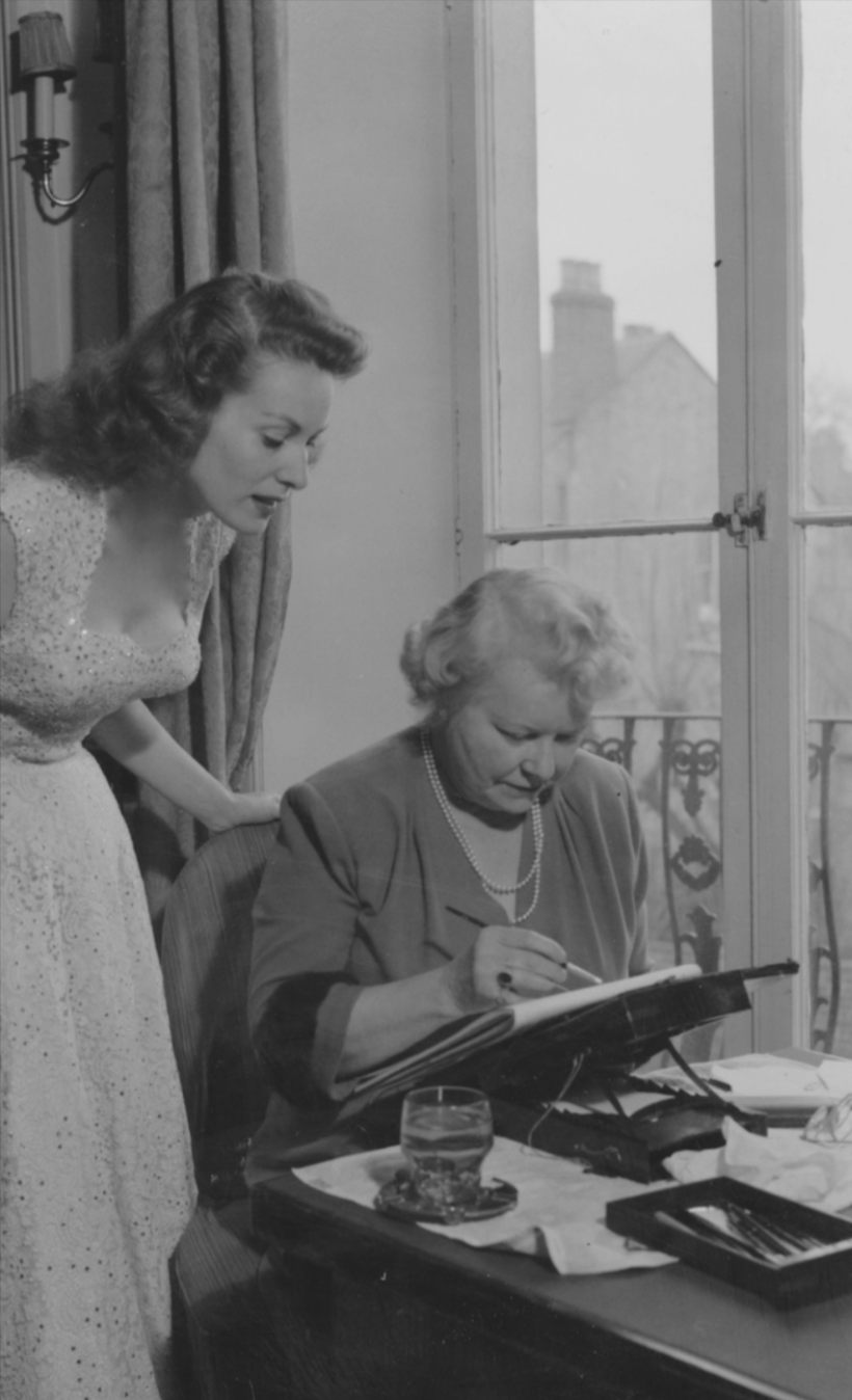 Maureen O'Hara looks at her portrait miniature painted by Stella Marks, at 27 Pembroke Gardens, London, 1953