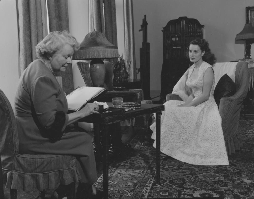 Maureen O'Hara sitting for a portrait miniature by Stella Marks, at 27 Pembroke Gardens, London, 1953