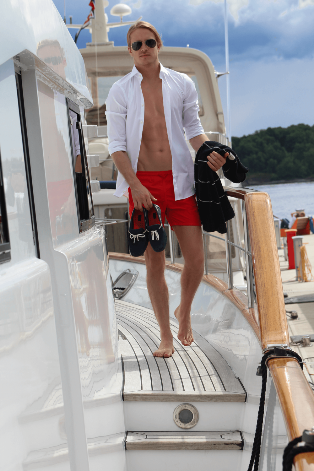 Wearing: Theo Blix Menswear Blogger Scandinavia, Men Blogger Norway,  Men Blogger Sweden , Vilebrequin Moorea solid red Swim Shorts,  Augustus Bernard Slim fit top, Rayban Aviator sunglasses, Swims shoes navy blue and white