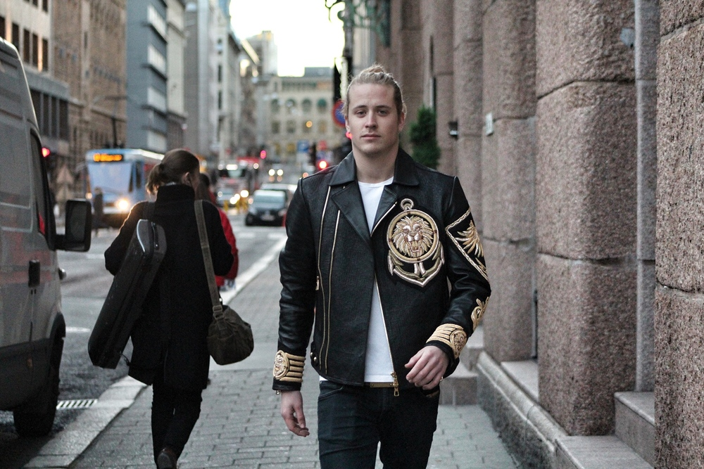 Theo Blix Mens Fashion Blog Balmain leather jacket with embroidery.Mens style blog, Scandinavian men,Men Long Hair style.Men's White Crew-neck T-shirt, BlackLeatherBomber Jacket, and black Jeans