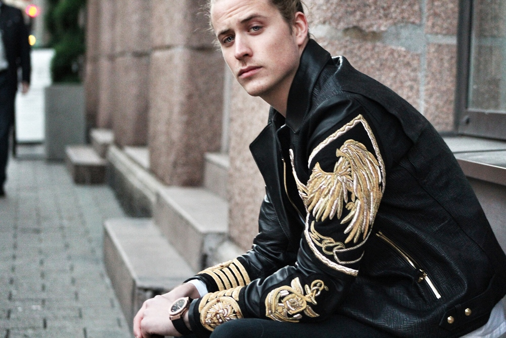 Theo Blix Mens Fashion Blog Balmain leather jacket with embroidery.Mens style blog, Scandinavian men, Men Long Hair style.Men's White Crew-neck T-shirt, BlackLeatherBomber Jacket, and black Jeans