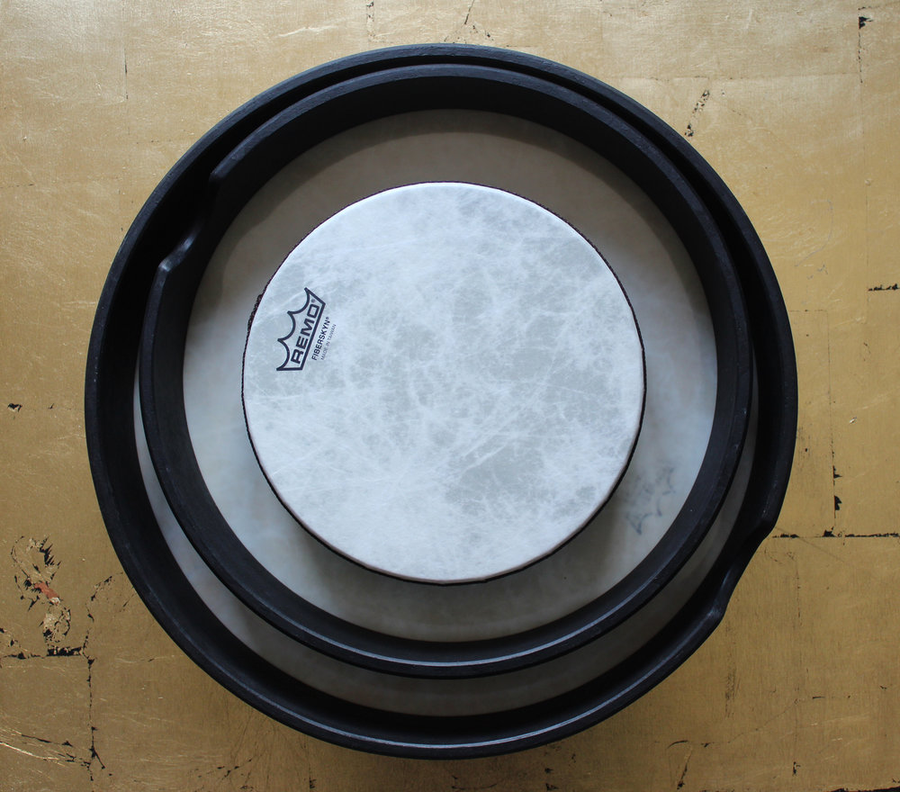 The Remo Frame drums have no handle, like the Buffalo drum. When you play them you hold onto the frame. One handy feature is that they stack inside each other. They come as small as 8 inches right up to 22 inches.