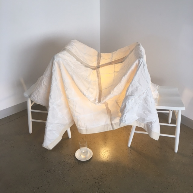 helding/holding , 2016, tissues, thread, calico and sleep, with wooden chairs, glass and saucer. Dimensions variable. Exhibited at Welcome the Light at FORM Gallery, Queanbeyan, 2016